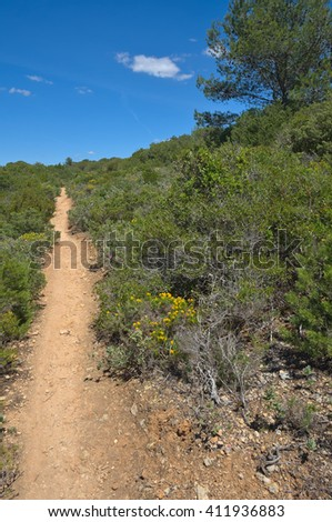 Hiking trail in Porches, Algarve, Portugal. Sports, nature and travel destinations - stock photo