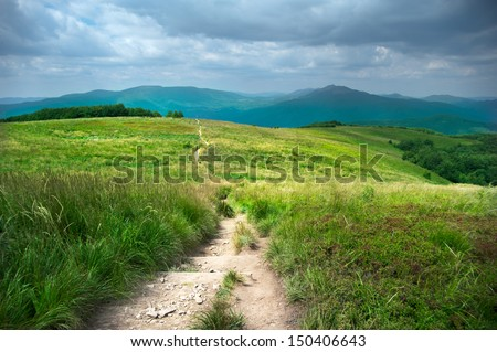 Hiking trail in the mountains - stock photo