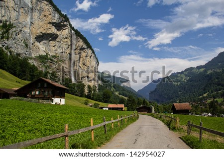 hiking trail in valley between stechelberg and lauterbrunnen Switzerland at daylight - stock photo