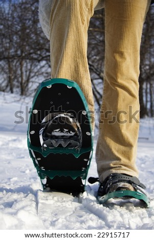 Hiking with snowshoes / rackets in Quebec, Canada - stock photo