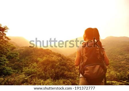 hiking woman enjoy the beautiful view at mountain peak  - stock photo
