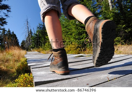 Hiking woman in trekking boots - stock photo