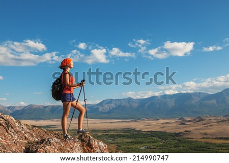 Hiking.Young woman hiker looking at the adventure ahead. - stock photo