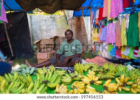 HIKKADUWA, SRI LANKA - FEBRUARY 23, 2014: Local street vendor selling bananas. The Sunday market is a fantastic way to see Hikkaduwa's local life come alive along with fresh produce and local delicacy - stock photo