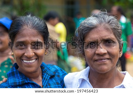 HIKKADUWA, SRI LANKA - FEBRUARY 23, 2014: Portrait of two local women at Sunday market. It is a great way to see Hikkaduwa's local life come alive along with fresh produce and local delicacy. - stock photo