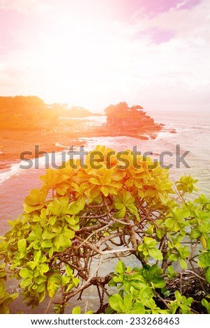 Hill overlooking an ancient Balinese temple at sunset, Bali. - stock photo