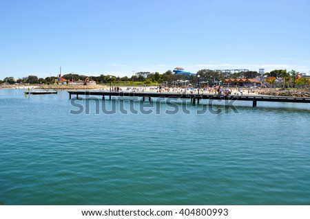 Hillarys Harbour with cove and people in Hillarys,Western Australia/Beach:Hillarys Cove/HILLARYS,WA,AUSTRALIA-JANUARY 22,2016:Jetty and cove in Hillarys Boat Harbour in Hillarys,Western Australia. - stock photo