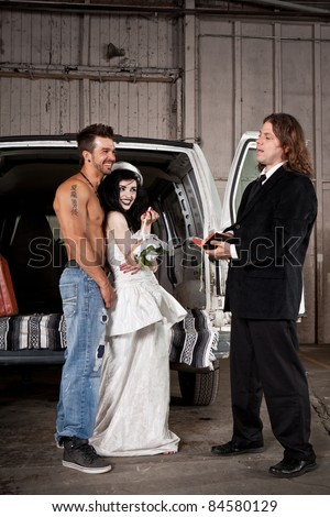 Hillbilly wedding (Shirtless guy and preacher) - stock photo