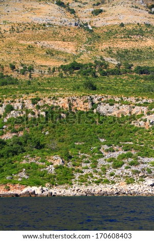 Hills covered with bushes on the coastal line of Adriatic sea - stock photo