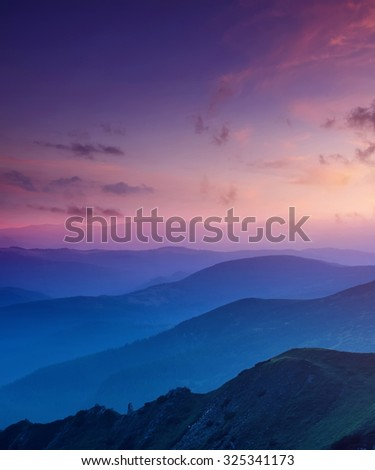 Hills lines in mountain valley during sunset. Natural summer mountain landscape - stock photo