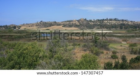 Hills overlooking marsh land in San Diego County, California - stock photo