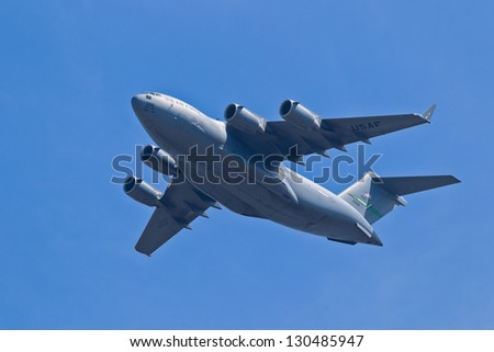 HILLSBORO, OR - AUG 5: Boeing C-17 Globemaster III aircraft fly by during Oregon Air Show at Hillsboro Airport on August 5, 2012 in Hillsboro, OR. - stock photo