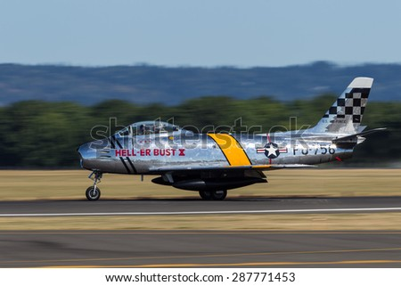 HILLSBORO, OR - SEPT 21: North American F-86F Sabre demonstration by the Bremont Horsemen Aerobatic Team during Oregon International Air Show at Hillsboro Airport on Sept 21, 2014 in Hillsboro, OR. - stock photo