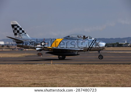 HILLSBORO, OR - SEPT 21: North American F-86F Sabre demonstration during Oregon International Air Show at Hillsboro Airport on September 21, 2014 in Hillsboro, OR.  - stock photo