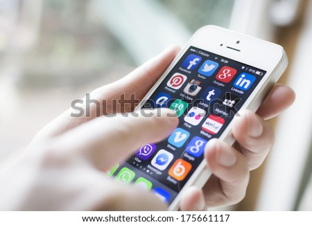 HILVERSUM, NETHERLANDS - FEBRUARY 06, 2014: Social media are trending and both business as consumer are using it for information sharing and networking. - stock photo