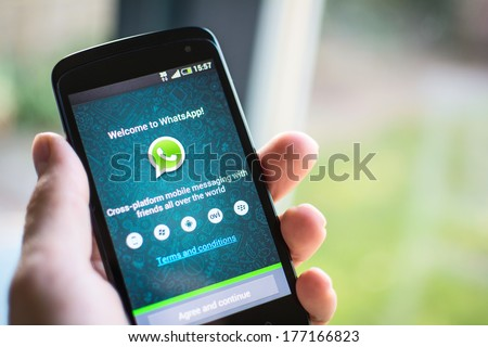 HILVERSUM, NETHERLANDS - FEBRUARY 2014, 2014: WhatsApp Messenger is a proprietary, cross-platform instant messaging subscription service for smartphones with Internet access founded in 2009. - stock photo