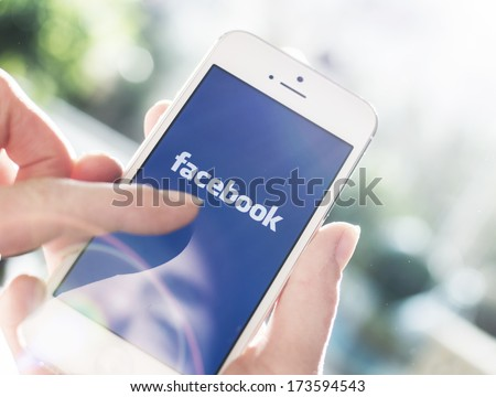 HILVERSUM, NETHERLANDS - JANUARY 28, 2014: Facebook is an online social networking service founded in February 2004 by Mark Zuckerberg with his college roommates and is now a fortune 500 company. - stock photo