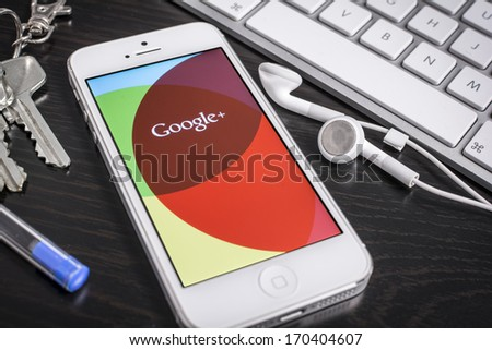 HILVERSUM, NETHERLANDS - JANUARY 08, 2014: Google+ is Google's social network service to compete with Facebook and launched in late June 2011 - stock photo