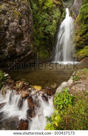 Himalaya Landscape: rocks and waterfall. Hiking in Nepal - stock photo