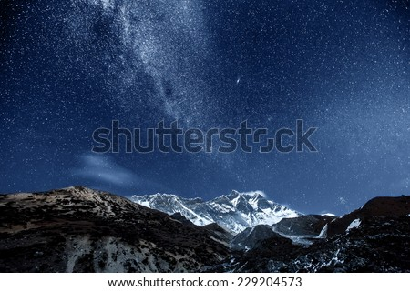 himalayan mountain Lhotse against dark blue sky with star in night time - stock photo