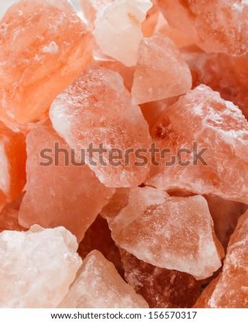Himalayan pink crystal salt background  - stock photo
