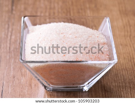 Himalayan pink salt in small bowl of glass. - stock photo