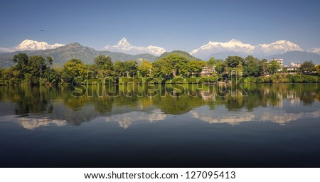 Himalayan range view with Pokhara and lake Phewa on a foreground - stock photo