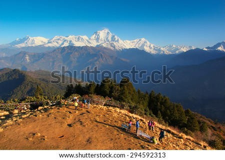 Himalayan view from poonhill with colorful prayer flags and clear blue sky in Muktinath, Upper Mustang, Nepal - stock photo