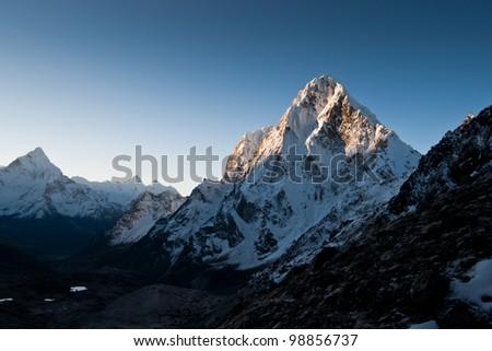 Himalayas: Cho La pass at dawn. Hiking in Nepal - stock photo