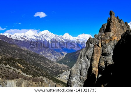 Himalayas mountains landscape view with rock in foreground, Nepal - stock photo