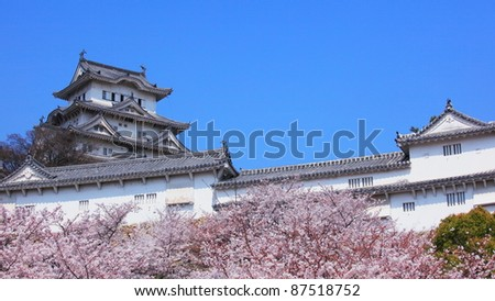 Himeji castle and spring cherry blossom, Japan - stock photo