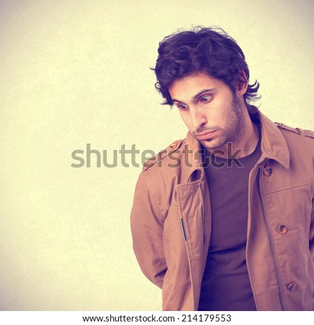 Hindu cool young man looking down - stock photo