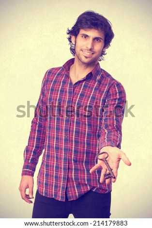 Hindu cool young man with a key - stock photo