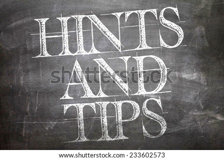 Hints and Tips written on blackboard - stock photo
