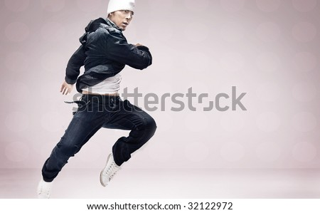 Hip Hop dancer jumping - stock photo