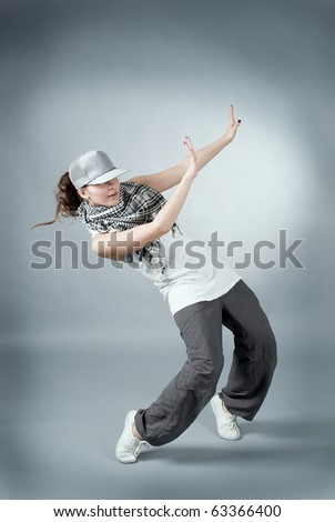 Hip hop female performing on  gray background - stock photo