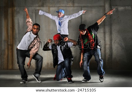 Hip hop men dancing over a grunge background - stock photo