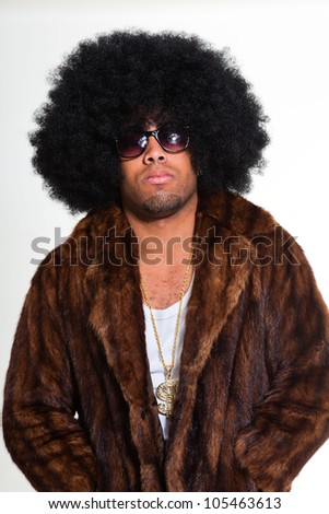 Hip hop urban black man retro afro hair wearing fur coat and golden jewelry isolated on white. Looking confident. Cool guy. Studio shot. - stock photo