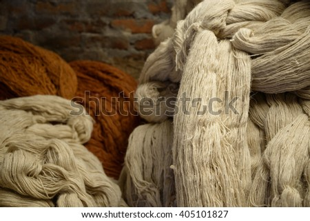 Hip of wool in a rug factory - stock photo