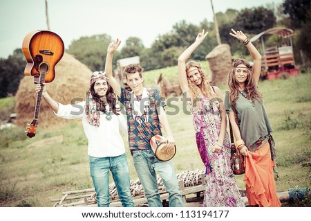 Hippie Group Dancing in the Countryside,Italy - stock photo