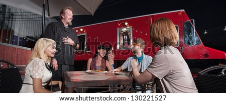 Hipster and friends talking with chef at canteen diner - stock photo