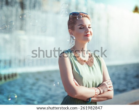 Hipster beautiful young girl in vintage clothing outdoor - stock photo