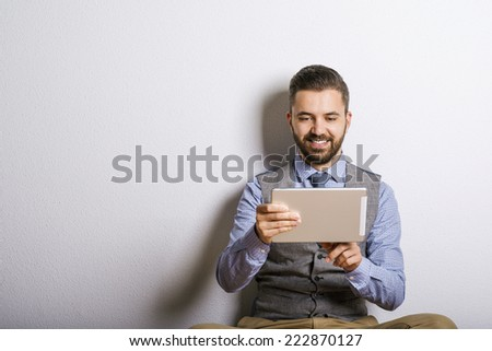 Hipster businessman with laptop - stock photo