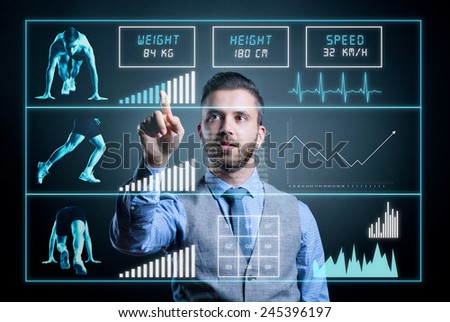 Hipster businessman working on digital virtual screen. Isolated on black background. - stock photo