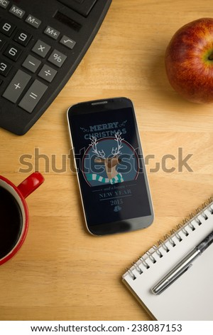 Hipster christmas message against overhead of smartphone with calculator - stock photo