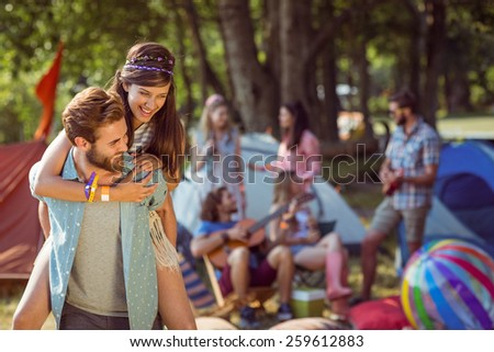 Hipster couple having fun on campsite at a music festival - stock photo