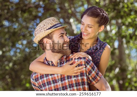 Hipster couple having fun together on a summers day - stock photo