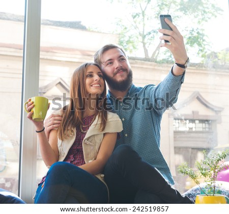 Hipster Couple Taking Selfie - stock photo
