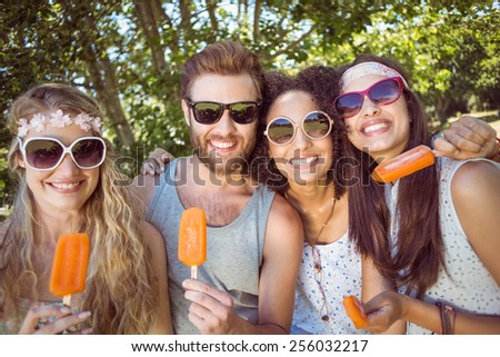 Hipster friends enjoying ice lollies on a summers day - stock photo