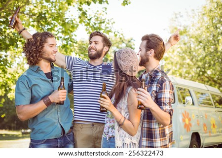 Hipster friends having a beer together on a summers day - stock photo